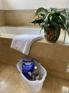 epsom salt or apple cider vinegar used in a bucket oot bath
