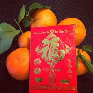 tangerines with stems and leaves represent good luck for Lunar New Year