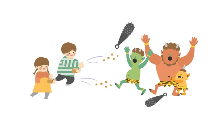 two children throwing beans at ogres for Japanese Bean Tossing Day